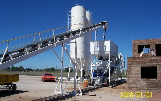Sistema de carga y distribuidor de áridos